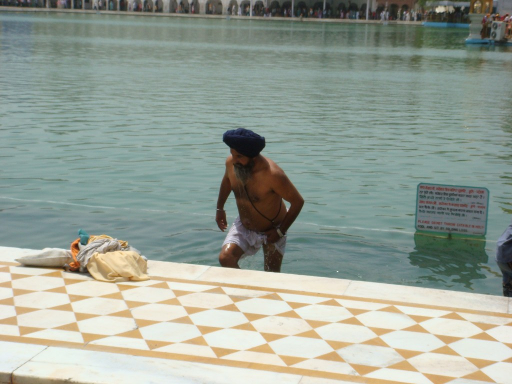 A pilgrim taking a dip in the holy lake