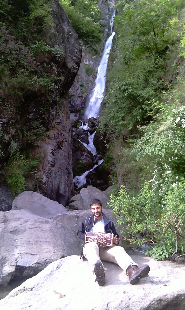 Me at the Vashisht Waterfall holding a friends drum